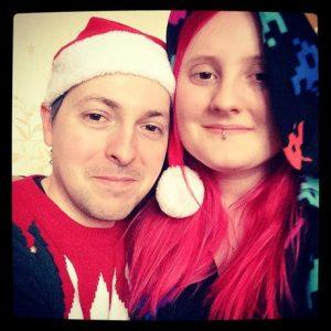 Christmas cuddle couple redhead